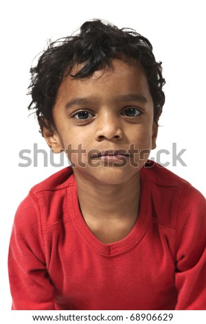 portrait of little Indian boy on a white background