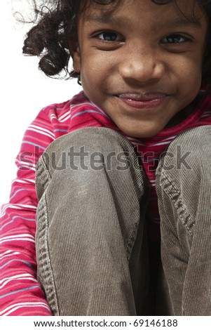 portrait of little Indian girl on a white background - stock photo