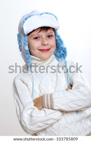 Portrait of little kid in winter wear against white background