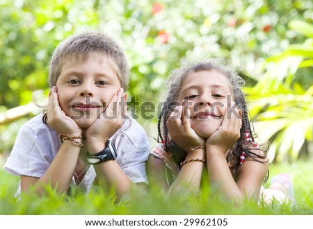 Portrait of little kids having good time in summer environment
