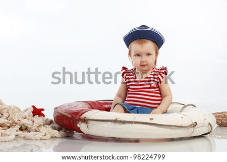Portrait of little pin-up fashion girl sea theme - stock photo