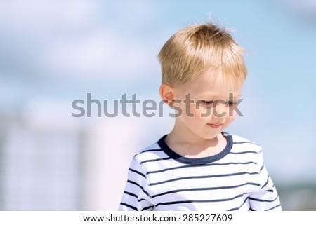 Portrait of little preschool boy outdoors. - stock photo