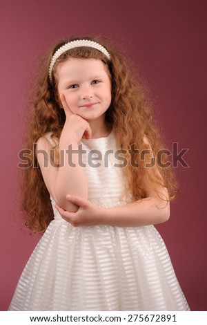 Portrait of little pretty girl over pink background - stock photo