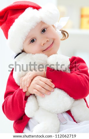 Portrait of little santa  girl with Christmas present - stock photo