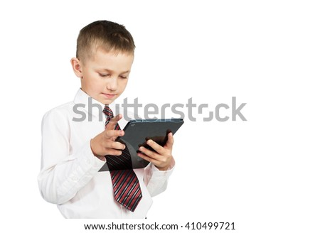 Portrait of little school boy using tablet pc. Education. White background Isolated - stock photo