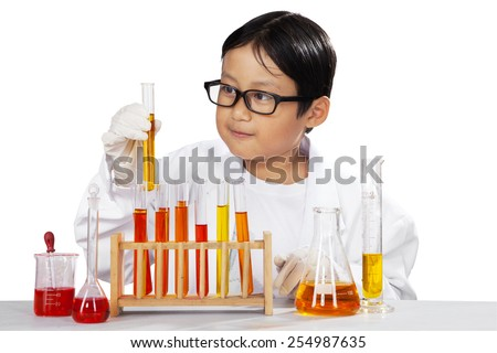 Portrait of little scientist holding beaker and looking the reaction, isolated over white - stock photo