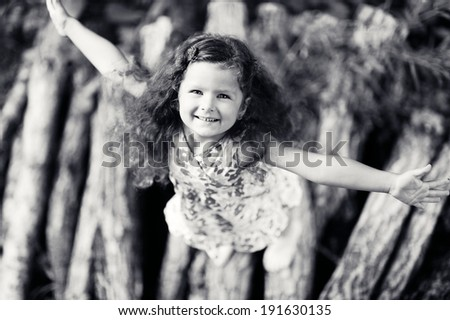 portrait of little smiling girl black and white picture
