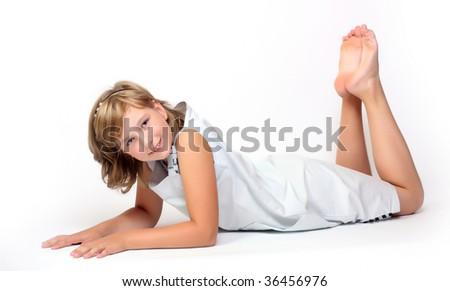 Portrait of little smiling girl posing in studio - stock photo