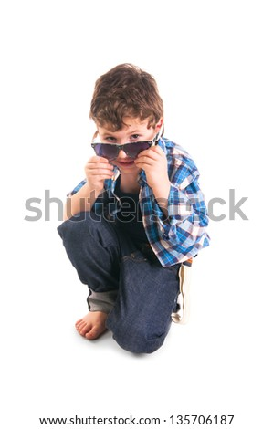 Portrait of little stylish boy with sunglasses isolated on white background