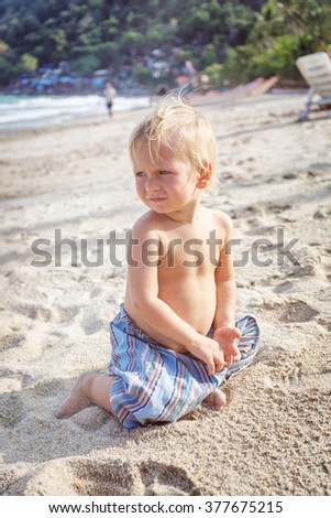 Portrait of little toddler on a beach