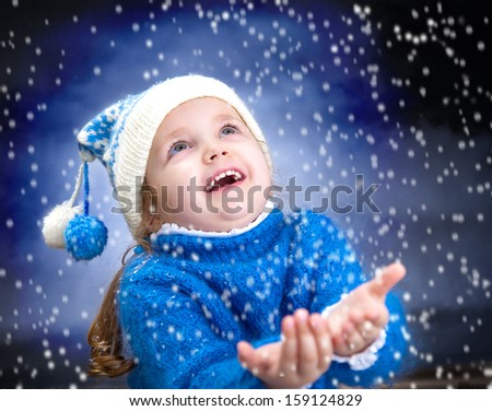 Portrait of little winter girl with snowflakes - stock photo