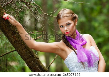 Portrait of long-hair girl in white dress and scarf at forest. - stock photo