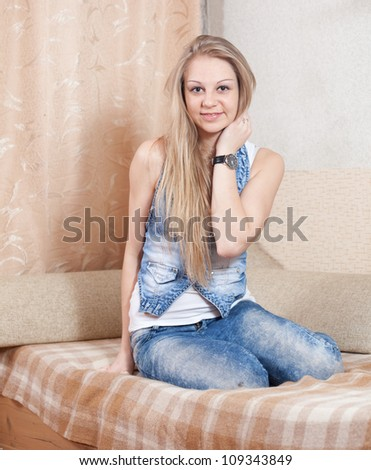 Portrait of long-haired girl in home interior - stock photo