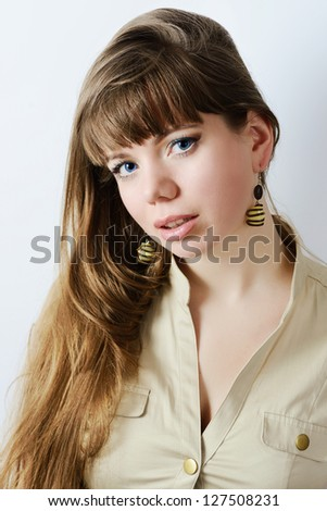 portrait of longhaired  girl with blue eyes  wearing   handmade bijouterie - stock photo