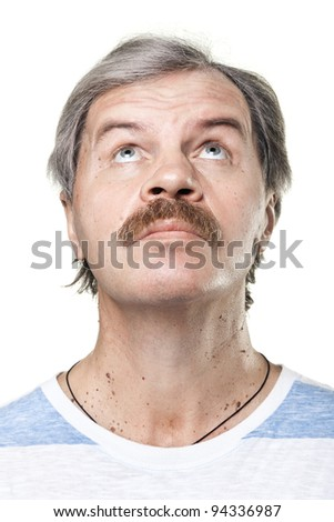 portrait of looking up mature man isolated on white background - stock photo