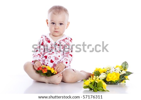 Portrait of lovely baby playing with flower on white background - stock photo