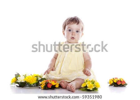 Portrait of lovely baby playing with flower on white background