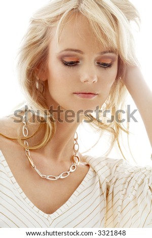 portrait of lovely blond with golden necklace - stock photo