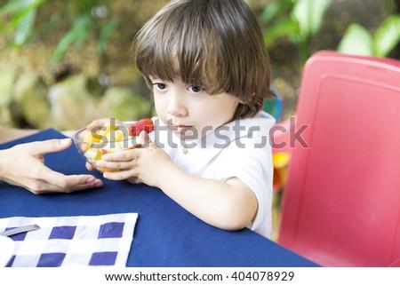 Portrait of Lovely Boy Having Picnic - stock photo
