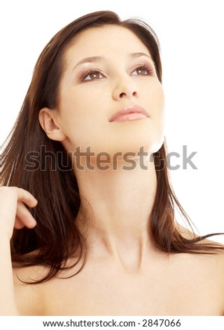 portrait of lovely brunette looking up over white