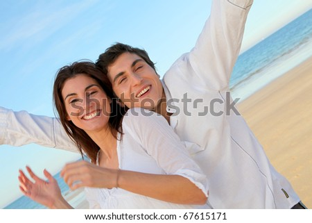 Portrait of lovely couple at the beach in summer