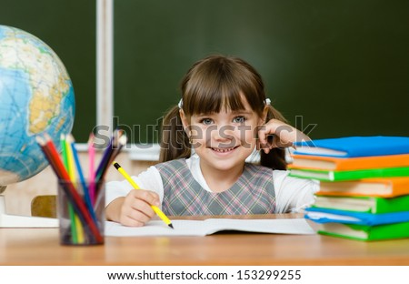 Portrait of lovely girl drawing in copybook - stock photo