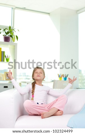 Portrait of lovely girl meditating at home - stock photo