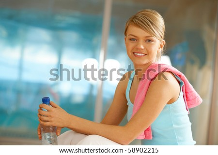 Portrait of lovely girl with bottle of water smiling - stock photo