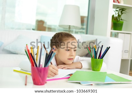 Portrait of lovely girl with colorful pencils near by - stock photo