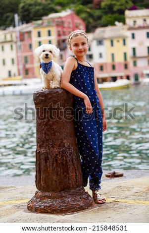 Portrait of lovely girl with dog - Portofino, Italy - stock photo