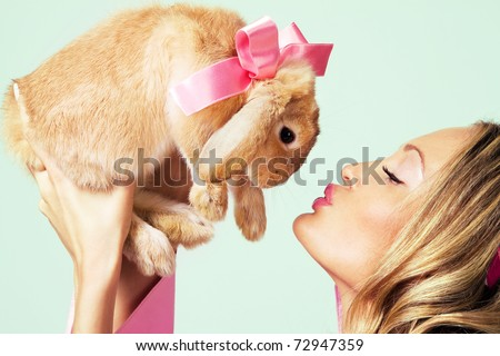 Portrait of lovely girl with rabbit - stock photo