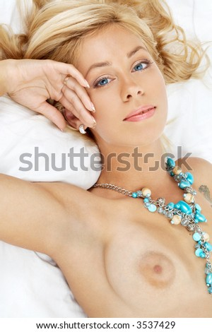 portrait of lovely lady laying in bed - stock photo