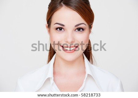 portrait of lovely smiley woman in white shirt