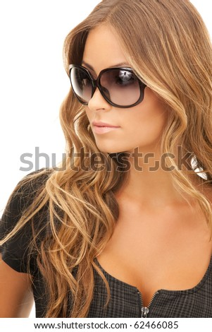 portrait of lovely woman in shades over white - stock photo