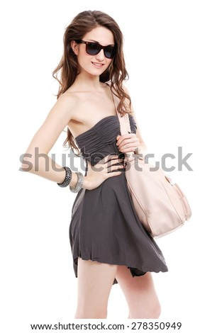 portrait of lovely woman in sunglasses with bag - stock photo