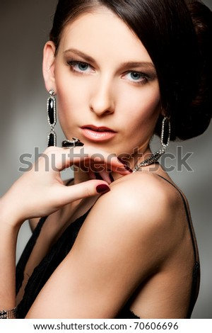 portrait of lovely woman over dark background - stock photo