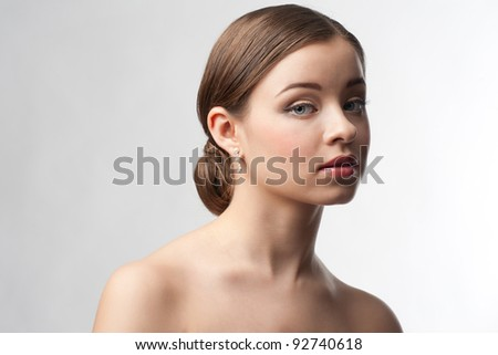 Portrait of lovely woman with beautiful make-up and hairstyle