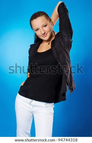 Portrait of lovely young elegant woman against blue background