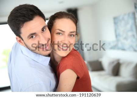 Portrait of loving couple at home - stock photo