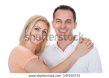 Portrait Of Loving Couple Embracing Isolated Over White Background - stock photo