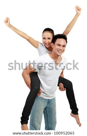 Portrait of loving couple having fun while piggyback ride isolated over white background