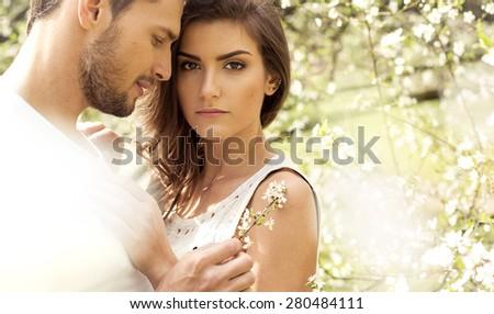 Portrait of loving couple in the garden - stock photo