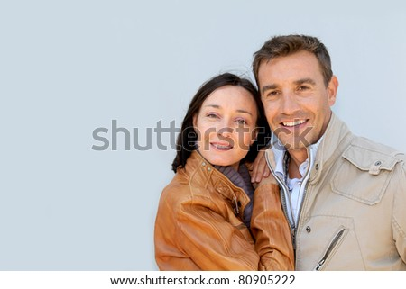 Portrait of loving couple with jackets on - stock photo