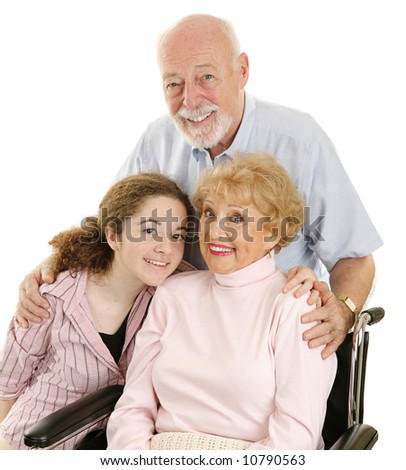 Portrait of loving grandparents and granddaughter.  Isolated on white. - stock photo