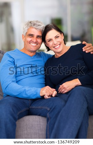 portrait of loving mature couple relaxing at home - stock photo