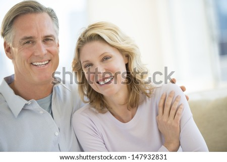 Portrait of loving mature couple smiling at home - stock photo