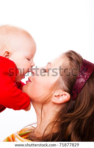 Portrait of loving mother and baby in red - stock photo