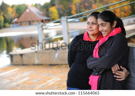 portrait of loving mother and daughter in outdoors