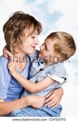 Portrait of loving mother with her son - stock photo