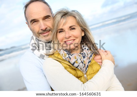 Portrait of loving senior couple at the beach - stock photo